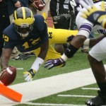 M FOOTBALL 2012-WILDCATS NO LONGER MILDCATS-WOLVERINES PREVAIL IN OVERTIME WITH 38 TO NORTHWESTERN'S 31.