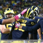 M FOOTBALL 2013: GALLON WATERS DOWN HOOSIER HOPES AS HE SETS RECORDS, AND THE WOLVERINES PREVAIL IN A 63 TO 47 SHOOTOUT