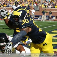 M FOOTBALL 2012-UNIVERSITY OF MASSACHUSETTS MINUTEMEN INVADE MICHIGAN STADIUM-WOLVERINES REPEL THEM 63 TO 13