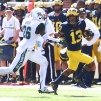 M FOOTBALL-2016: WOLVERINE SEASON BLASTS OFF BY DOMINATING HAWAII, 63 TO 3