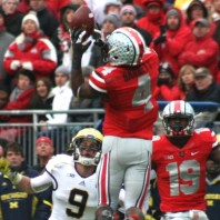 THE GAME-THE WOLVERINES TRAVELED TO COLUMBUS TO WREST AN UNBEATEN REGULAR SEASON FROM THE BUCKEYES, AND POSSIBLY A SPOT IN THE BIG TEN TITLE GAME, BUT DID NOT PREVAIL: MICHIGAN 21, OHIO 26.